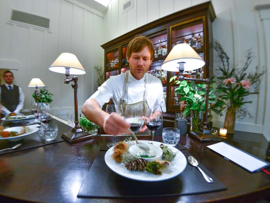 Rasmus Kofoed and table-side plating. Photo: Bonjwing Lee Photography