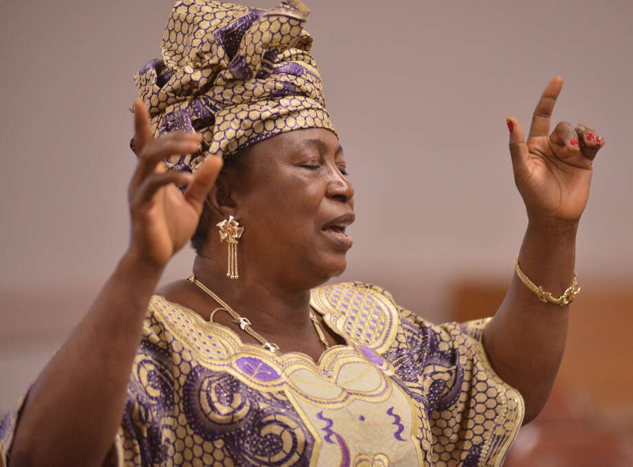 Betty Ngaima, a member of God Inspiration Church International, lifts her voice in song during recent services.