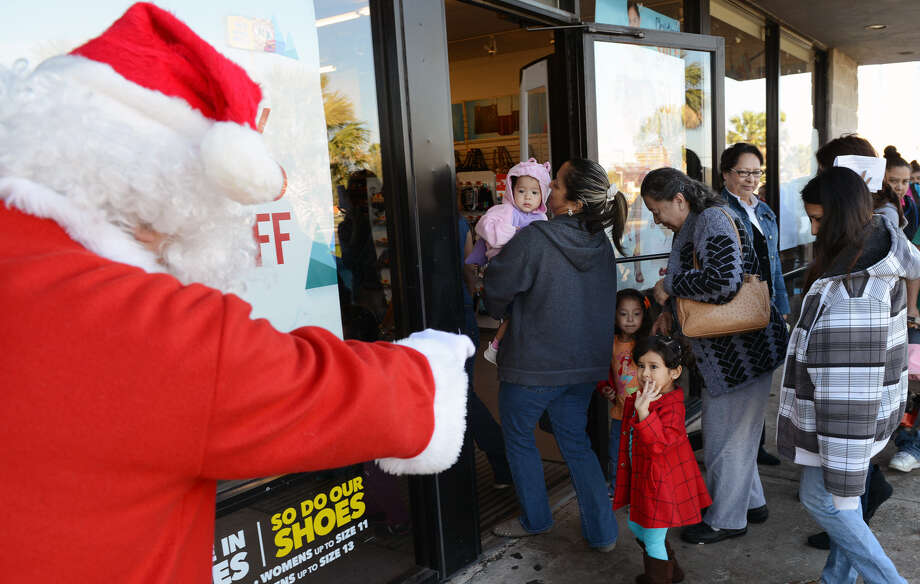 A little girl in Brownsville interacts with Santa recently at Payless Shoes. Though this event was a giveaway, shopping and gift-giving are low on many people's lists of favorite Christmas activities. Photo: Brad Doherty / Brownsville Herald / Brownsville Herald