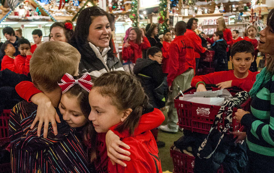 Pupils in Frankenmuth, Mich., prepare to shop for gifts together as part of a mentoring program pairing students not receiving special education services with those who are. Photo: Jake May / Associated Press / The Flint Journal-MLive.com