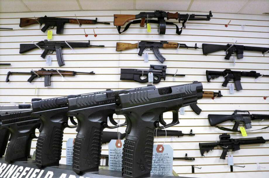 Guns that are considered assault weapons and large-capacity ammunition magazines that haven't been registered with Connecticut authorities will be considered illegal contraband. The law was passed in April in response to the massacre that left 26 people dead at Newtown's Sandy Hook Elementary School. Photo: Seth Perlman, AP / AP