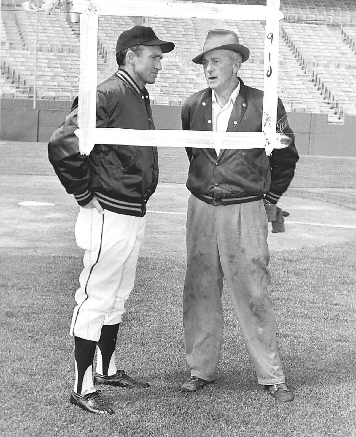 4/16/63- San Francisco Giants Manager Alvin Dark (L) chats with Giants groundskeeper Matty Schwab as the pair check the field at Candlestick Park her 4/16 just before the Giants home opener.