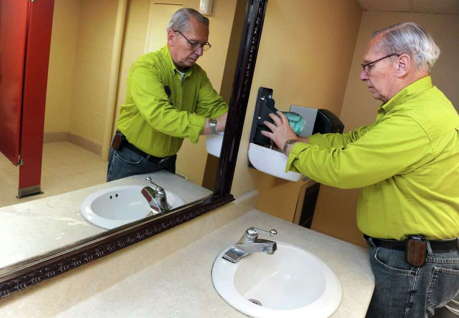 Donald Darling, 75, of Stratford, replaces soap in the bathroom dispenser, part of his regular duties as maintenance man at the Trumbull Senior Center.  Darling, a self-described jack of all trades, handles whatever comes up at the center from fixing tables to building an outside shed. Photo: Autumn Driscoll / Connecticut Post