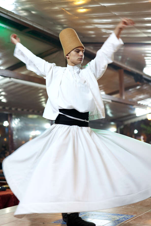 ] In Turkey, a dervish spins in a prayerful trance, meditating on the divine power of love, the greatness of God, and freedom from worldly desires.  (photo: Dominic Bonuccelli/Rick Steves' Europe) Photo: Dominic Arizona Bonuccelli / Azfoto.com, Ricksteves.com / dominic arizona bonuccelli / azfoto.com