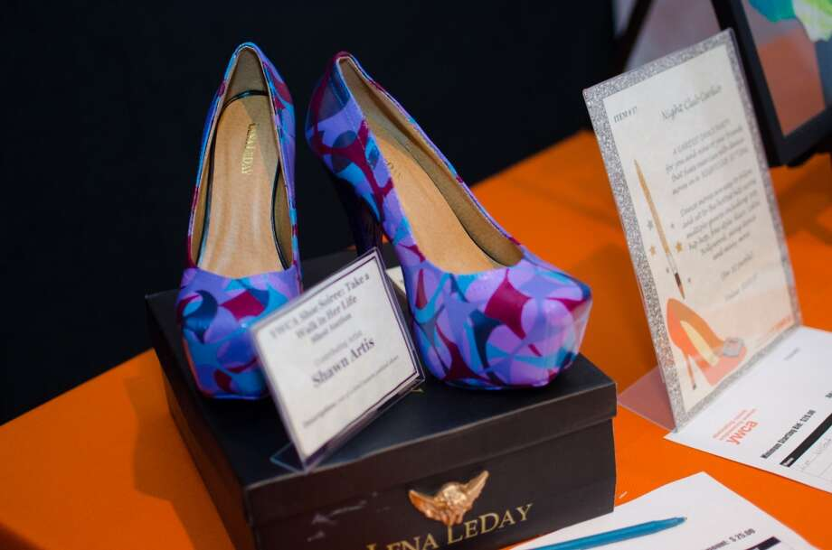 A pair of shoes by contributing Artist Shawn Artis up for auction during YWCA of Houston's Shoe Soiree Fundraiser at the YWCA Gateway Center in Houston, TX on Friday, Dec. 13. Photo: Jamaal Ellis, For The Chronicle