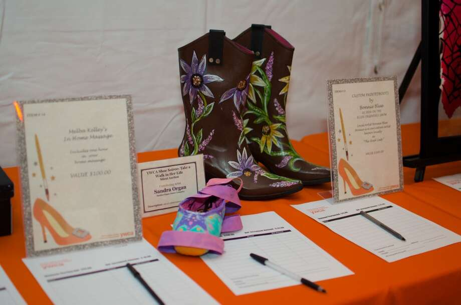 A pair of shoes by contributing Artist Sandra Organ and Boots by Bonnie Blue up for auction during YWCA of Houston's Shoe Soiree Fundraiser. Photo: Jamaal Ellis, For The Chronicle