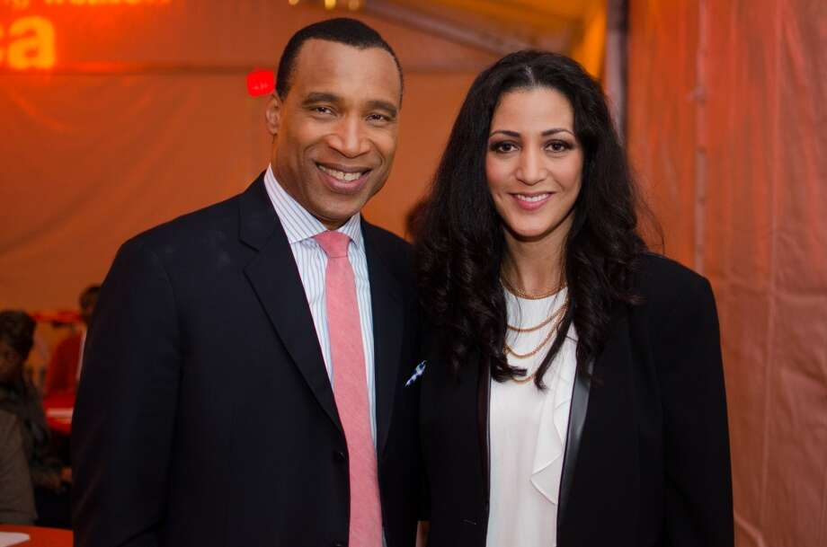 Emcee Len Cannon and YWCA CEO Rayanne Darensbourg during YWCA of Houston's Shoe Soiree Fundraiser at the YWCA Gateway Center in Houston, TX on Friday, Dec. 13. Photo: Jamaal Ellis, For The Chronicle