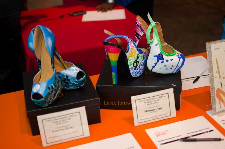 Pairs of shoes by contributing Artists Vonetta Berry and Monica Pope up for auction during YWCA of Houston's Shoe Soiree Fundraiser. Photo: Jamaal Ellis, For The Chronicle