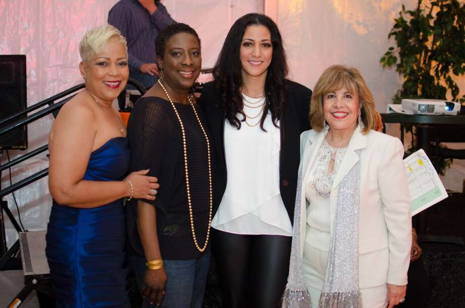 Board Members Terri Broussard Davis, Cyndi Stewart, Rayanne Darensbourg, and M. Helen Cavazos during YWCA of Houston's Shoe Soiree Fundraiser. Photo: Jamaal Ellis, For The Chronicle