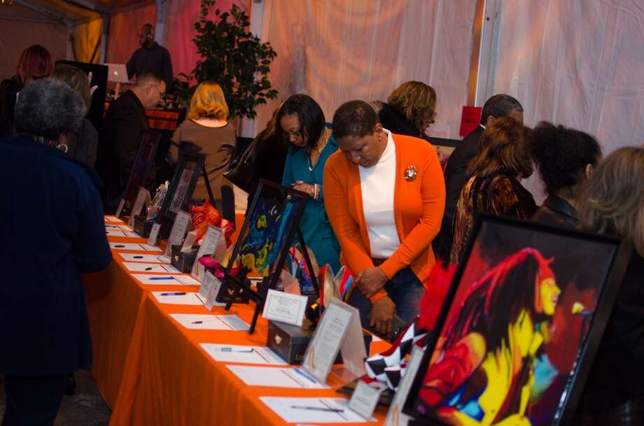 Attendees looking at items up for auction during YWCA of Houston's Shoe Soiree Fundraiser. Photo: Jamaal Ellis, For The Chronicle