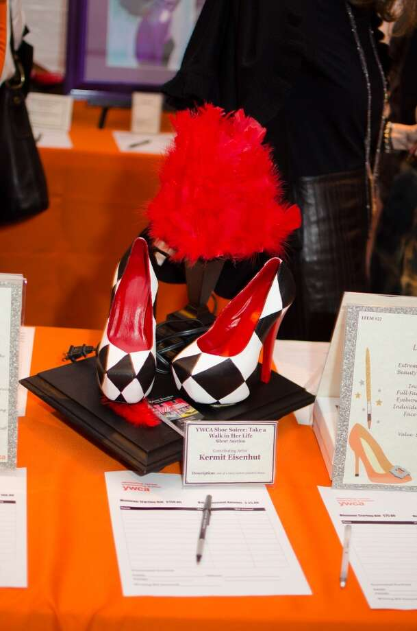 A pair of shoes by contributing Artist Kermit Eisenhut up for auction during YWCA of Houston's Shoe Soiree Fundraise. Photo: Jamaal Ellis, For The Chronicle
