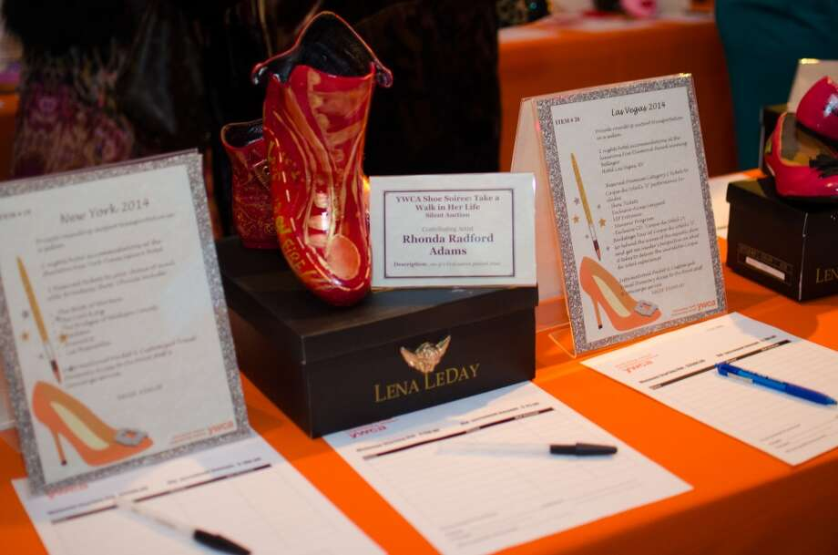 A pair of shoes by contributing Artist Rhonda Radford Adams up for auction during YWCA of Houston's Shoe Soiree Fundraiser. Photo: Jamaal Ellis, For The Chronicle