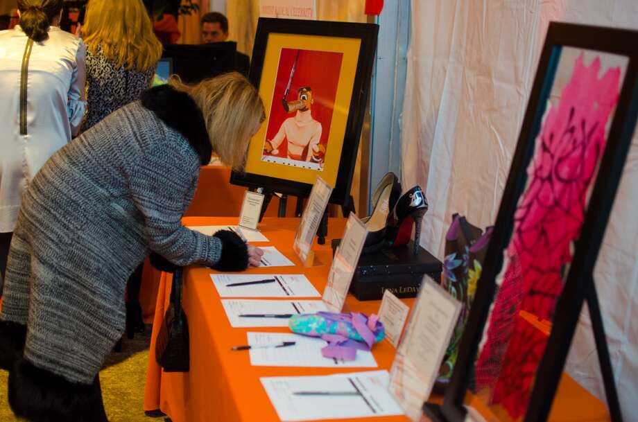 Auction items being bid on during YWCA of Houston's Shoe Soiree Fundraiser. Photo: Jamaal Ellis, For The Chronicle