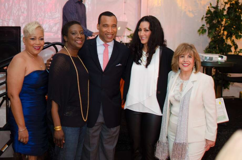 Board Members Terri Broussard Davis, Cyndi Stewart, Rayanne Darensbourg, and M. Helen Cavazos with Len Cannon (C) during YWCA of Houston's Shoe Soiree Fundraiser. Photo: Jamaal Ellis, For The Chronicle