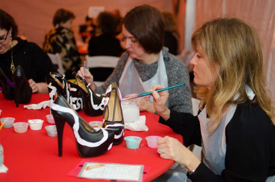 Lisa Brennan Paints a pair of heels during YWCA of Houston's Shoe Soiree Fundraiser. Photo: Jamaal Ellis, For The Chronicle