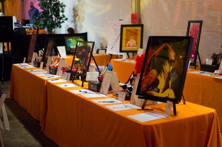 Art and shoes up for auction during YWCA of Houston's Shoe Soiree Fundraiser. Photo: Jamaal Ellis, For The Chronicle