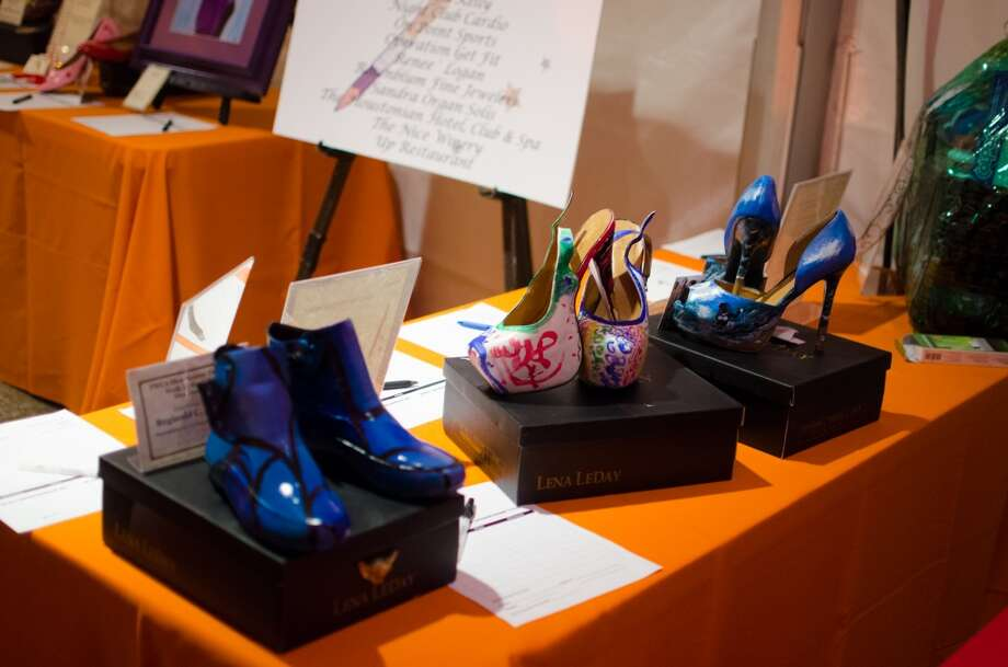 Shoes up for auction during YWCA of Houston's Shoe Soiree Fundraiser. Photo: Jamaal Ellis, For The Chronicle
