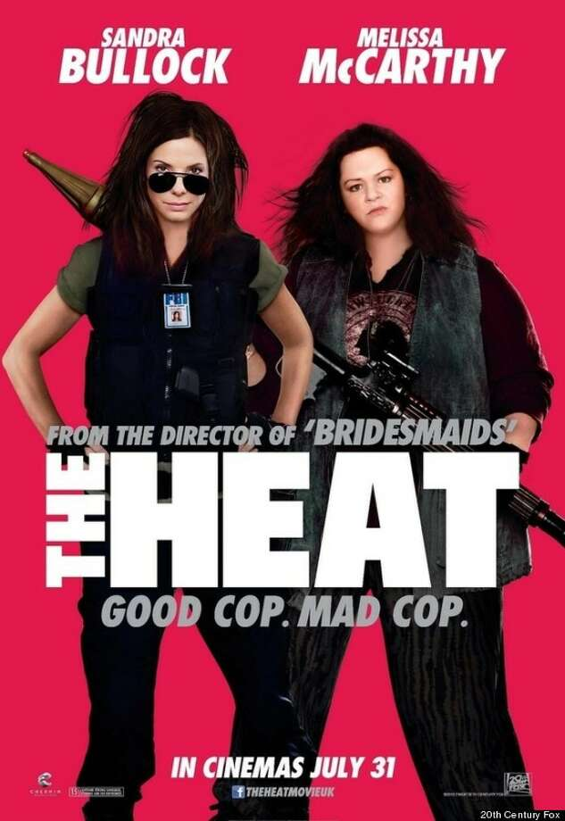 THE HEAT - The now infamous poster which was read its rights earlier this year for the horrible and unnecessary doctoring of Melissa McCarthy's face. Sandra Bullock's hair didn't fare much better