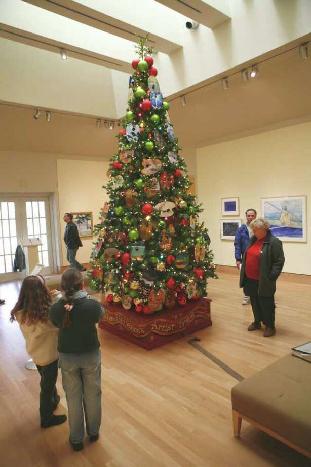 Artists' palettes adorn the tall Christmas tree that greets visitors to the Florence Griswold Museum in Old Lyme. The museum's holiday celebrations continue through Jan. 9. Photo: Contributed Photo, Stamford Advocate / Stamford Advocate Contributed