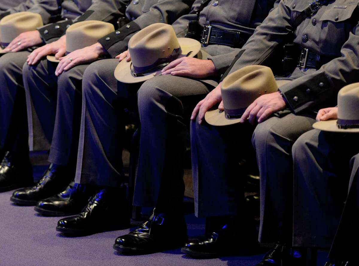 The long gray line of troopers gather for the funeral service of Trooper David Cunniff Friday, Dec. 20, 2013, at Grace Fellowship Church in Colonie, N.Y. Trooper Cunniff was killed Monday night while making a traffic stop on the NYS Thruway near Amsterdam, N.Y. (Skip Dickstein / Times Union)