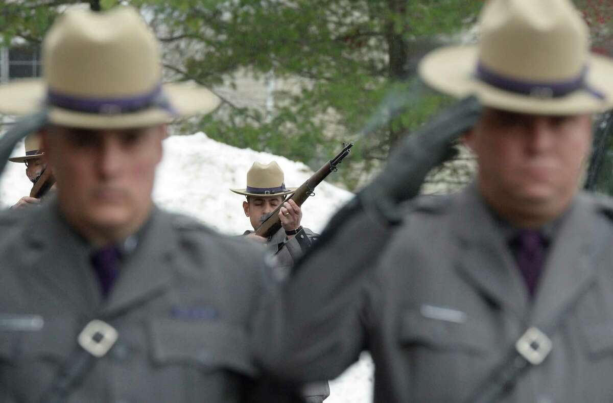 Troopers fire a salute during funeral services for Trooper David Cunniff Friday, Dec. 20, 2013, at Grace Fellowship Church in Colonie, N.Y. Trooper Cunniff was killed Monday night while making a traffic stop on the NYS Thruway near Amsterdam, N.Y. (Skip Dickstein / Times Union)