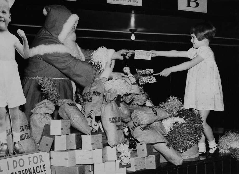 A girl gets a toy from Santa at the New Tabernacle Sick and Provident Society on Dec. 19, 1936. Photo: KEYSTONE FRANCE, Getty Images / KEYSTONE FRANCE
