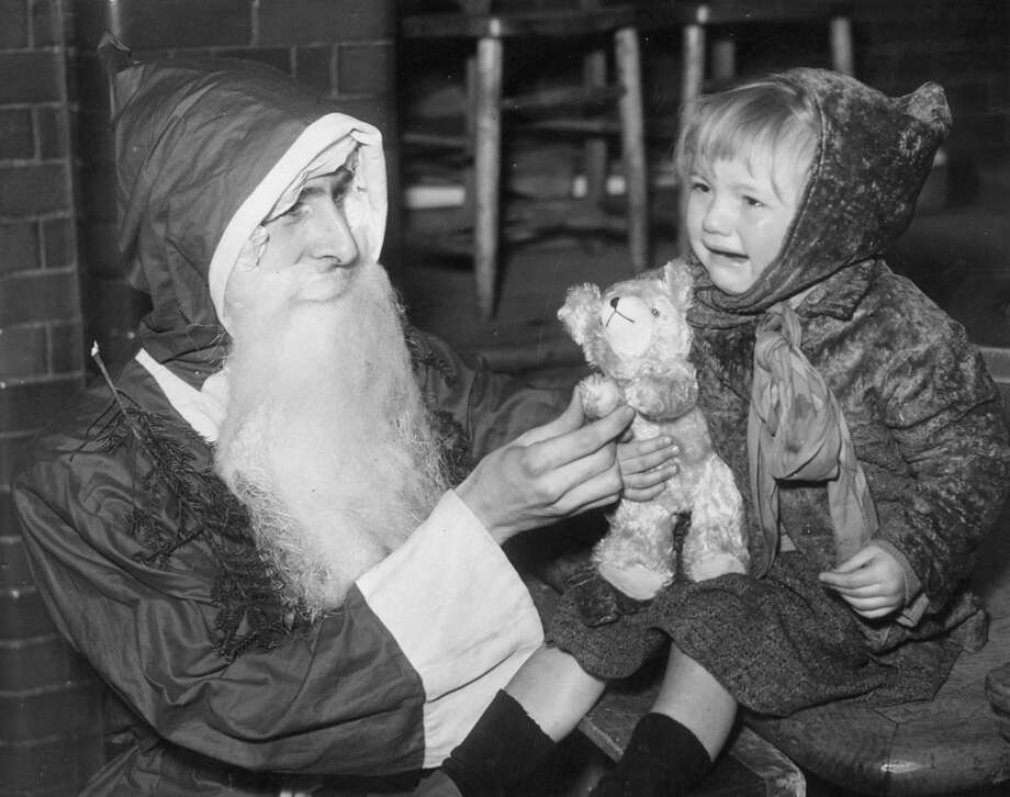 A child visiting Santa in Hoxton, United Kingdom, is unhappy despite her new teddy bear, Dec. 27, 1939. Photo: Parker, Getty Images / Hulton Archive