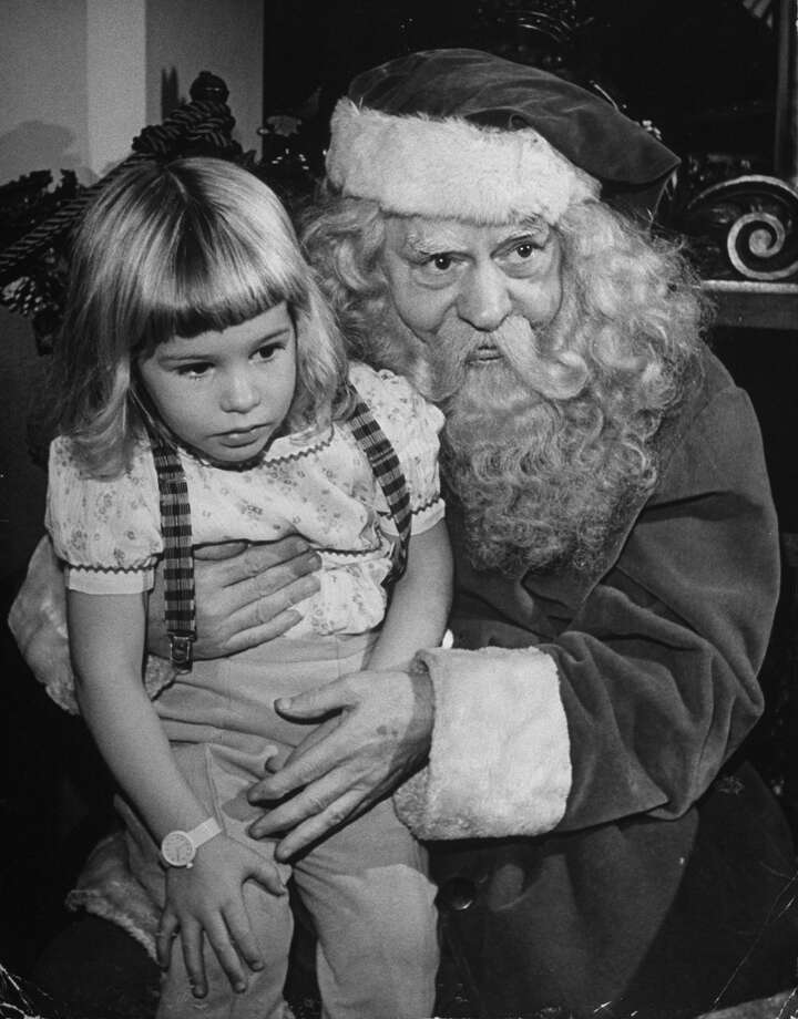 A department store Santa Claus poses with an anxious-looking little girl on Nov. 30, 1944. Photo: Alfred Eisenstaedt, Time & Life Pictures/Getty Images / Time Life Pictures