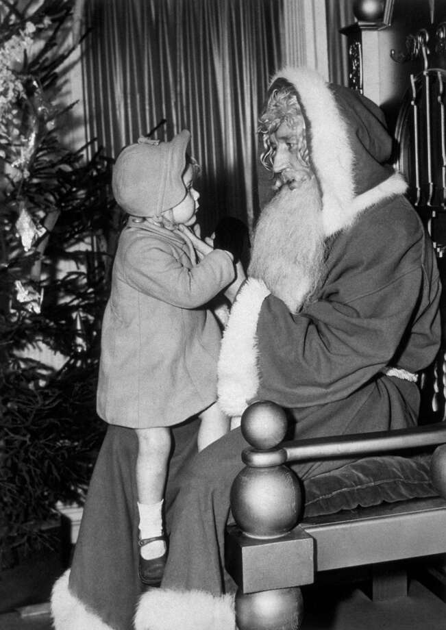A young visitor to a West End store in the United Kingdom makes sure that her Christmas requests are fully understood by Santa Claus, circa 1946. Photo: Topical Press Agency, Getty Images / Hulton Archive