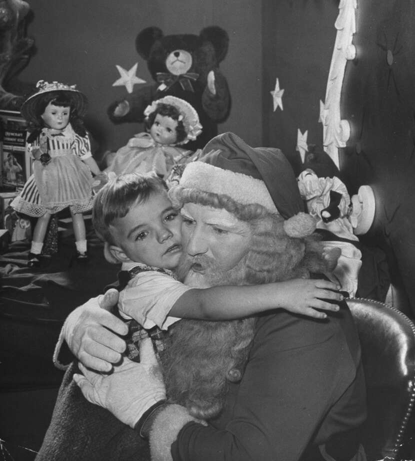 A child hugs Santa Claus, circa 1946. Photo: Frank Scherschel, Time & Life Pictures/Getty Images / Time & Life Pictures