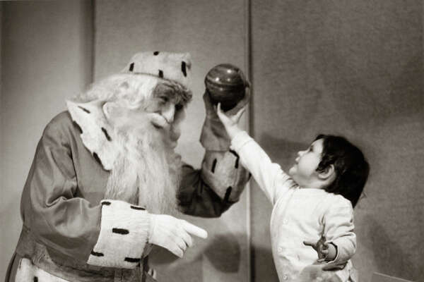 UNITED STATES - CIRCA 1950s: Santa Claus with little girl.