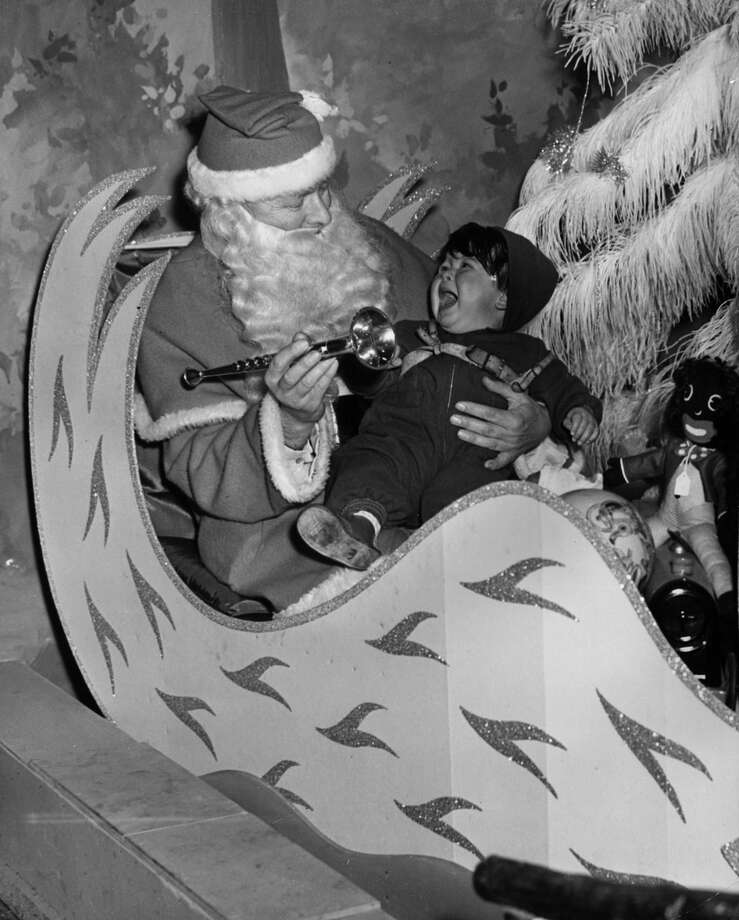 A young infant finds meeting Father Christmas for the first time all too much at the Arding And Hobbs department store in London on Nov. 20, 1954. Photo: Meager, Getty Images / Hulton Archive