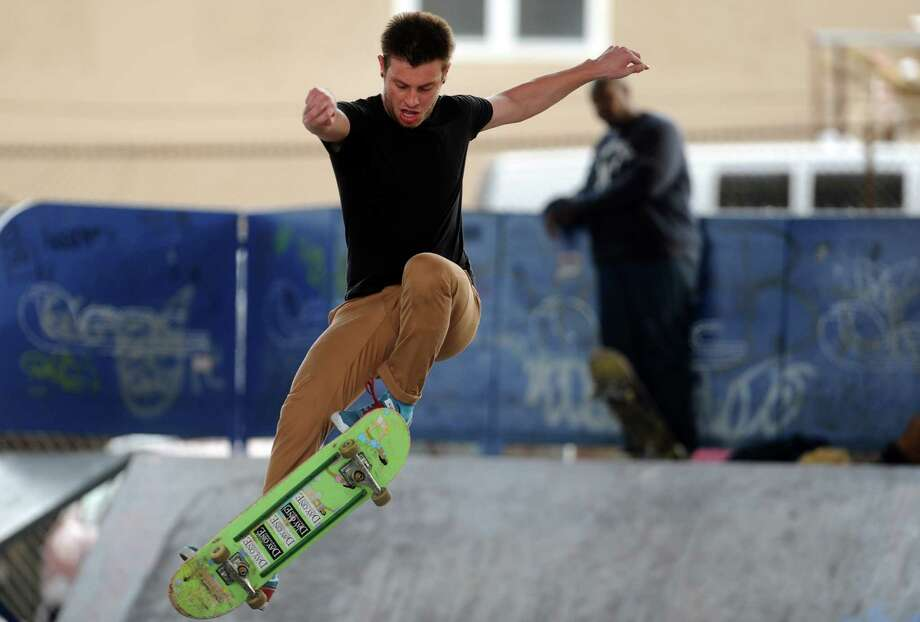 Tim Rinkerman, of Seymour, attempts a frontside ollie 180 Friday, Dec. 20, 2013 at the skate park in Shelton, Conn. Photo: Autumn Driscoll / Connecticut Post