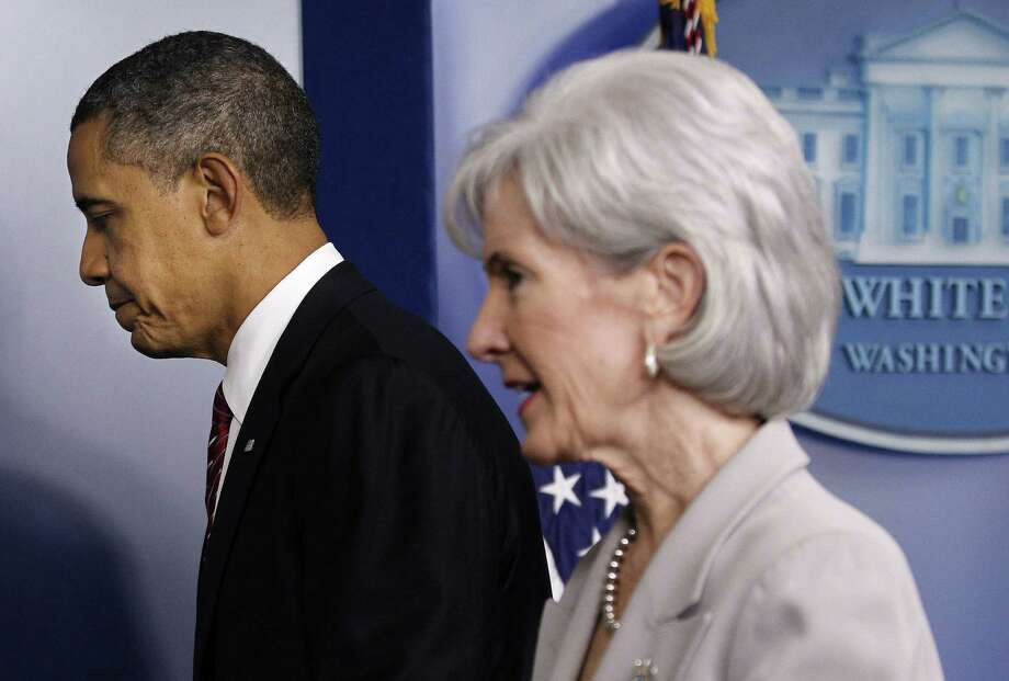 President Barack Obama and Health and Human Services Secretary Kathleen Sebelius haven't had much to smile about lately. From the onset, the ACA has been mired in technological, philosophical and administrative problems. Oh, and one big lie Obama can't live down. What more can possibly go wrong in 2014? Stay tuned. Photo: Associated Press / AP