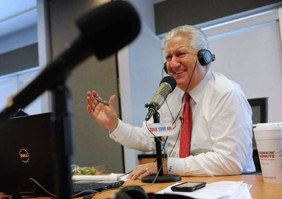 Albany Mayor Jerry Jennings hosts his final radio show from a conference room at the Time Warner Cable News studios on Friday, Dec. 20, 2013 in Albany, N.Y. (Lori Van Buren / Times Union) Photo: Lori Van Buren / 00025110A
