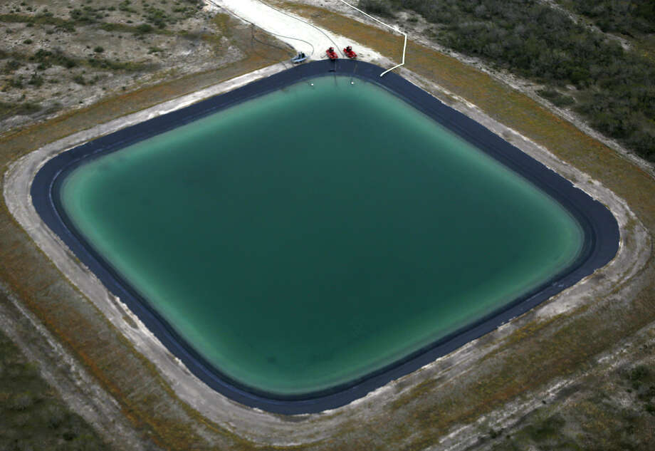 A retention pond in the Eagle Ford Shale region is indicative of the huge need for freshwater and brackish water — the lifeblood of fracking. Photo: William Luther / San Antonio Express-News / San Antonio Express-News
