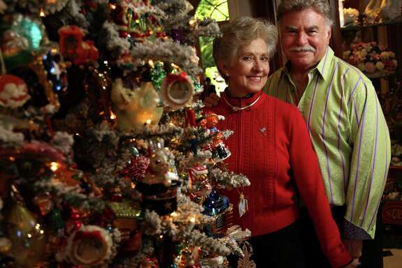 This 11-foot-tall Christmas tree in Gigi and Stewart Shapiro's Tanglewood home takes 30 hours to decorate.