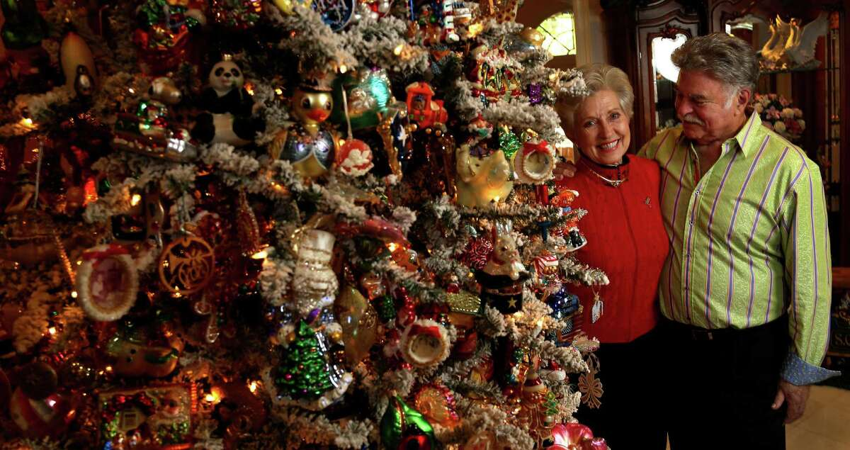 Gigi and Stewart Shapiro stand in their Tanglewood home which is decorated to the chandelier with Christmas decorations including this 10-foot-tall Christmas tree that takes 30 hours to decorate. Photographed, Tuesday, Dec. 3, 2013, in Houston. ( Karen Warren / Houston Chronicle )