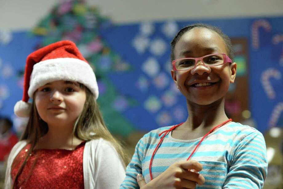 Students of Hall elementary school waiting in line to receive gifts from Santa.  The gifts were donated by Sikorsky Finance Women's Forum. Photo: Andrew Merrill