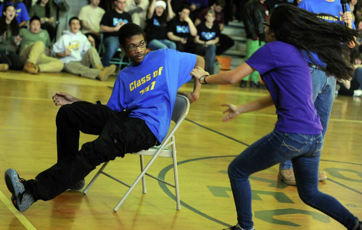 Sophomore Dalina Tavarez, of Bridgeport, is a moment too late as freshman Dominique Reid takes the open seat Friday, Dec. 20, 2013 during musical chairs, part of the class wars at Emmett OâÄôBrien High School in Ansonia, Conn.
