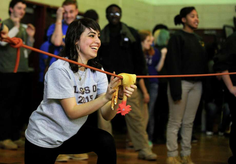 Junior Alexandra Garcia, of Bridgeport, sends a rubber chicken flying Friday, Dec. 20, 2013 in one of the challenges during class wars at Emmett O'Brien High School in Ansonia, Conn. Photo: Autumn Driscoll / Connecticut Post