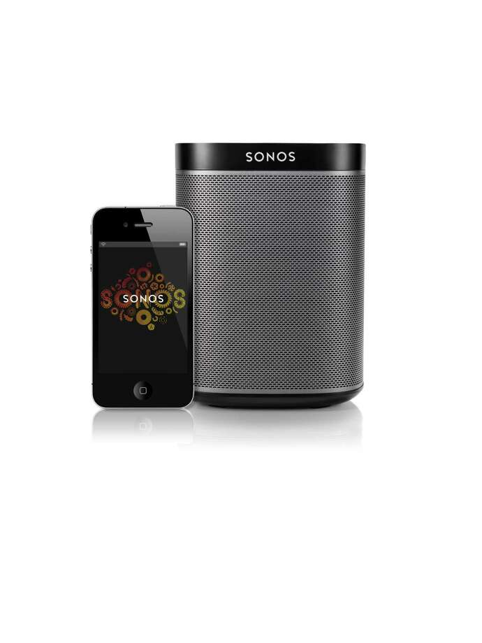 This photo provided by Sonos shows an iPhone and Sonos Black Play 1. Sonos speakers run over Wi-Fi and need to be plugged into a power outlet. The speakers are designed to disperse sound in a wide radius and fill a room with sound. (AP Photo/Sonos) ORG XMIT: CAET491 Photo: KrugCapture / Sonos