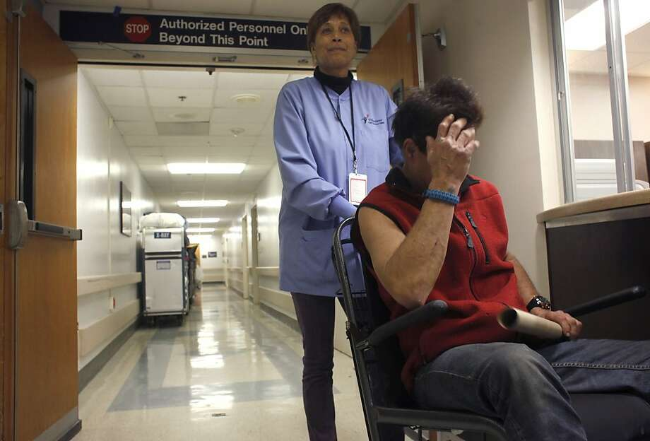 Bernadette Luckett escorts a patient to the radiology department as a volunteer at the San Francisco VA Medical Center. Photo: Lacy Atkins, The Chronicle
