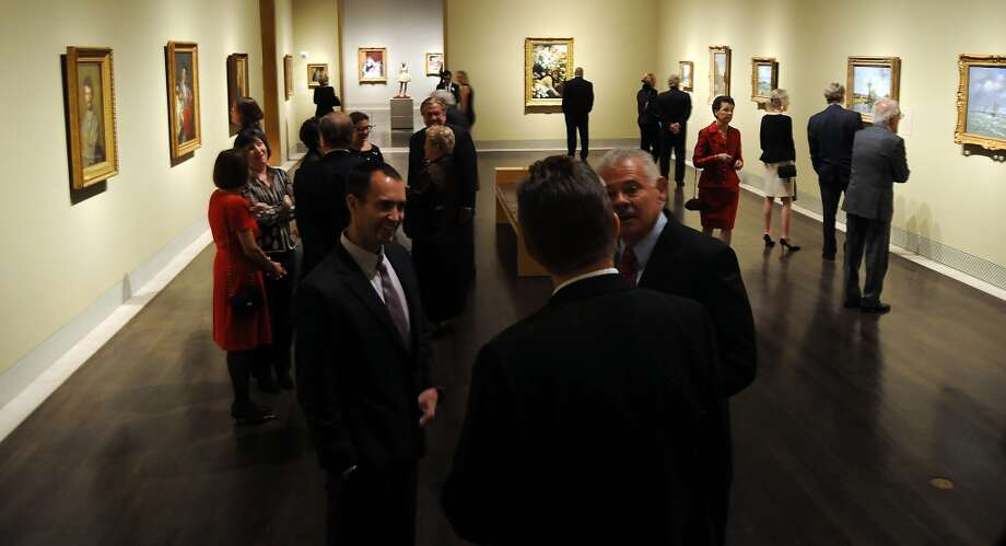 "Guests view the exhibit at the fund raisers dinner at the Museum of Fine Arts Houston celebrating ""The Age of Impressionism"" Thursday Dec. 19, 2013. (Dave Rossman photo) Photo: Dave Rossman, For The Houston Chronicle"