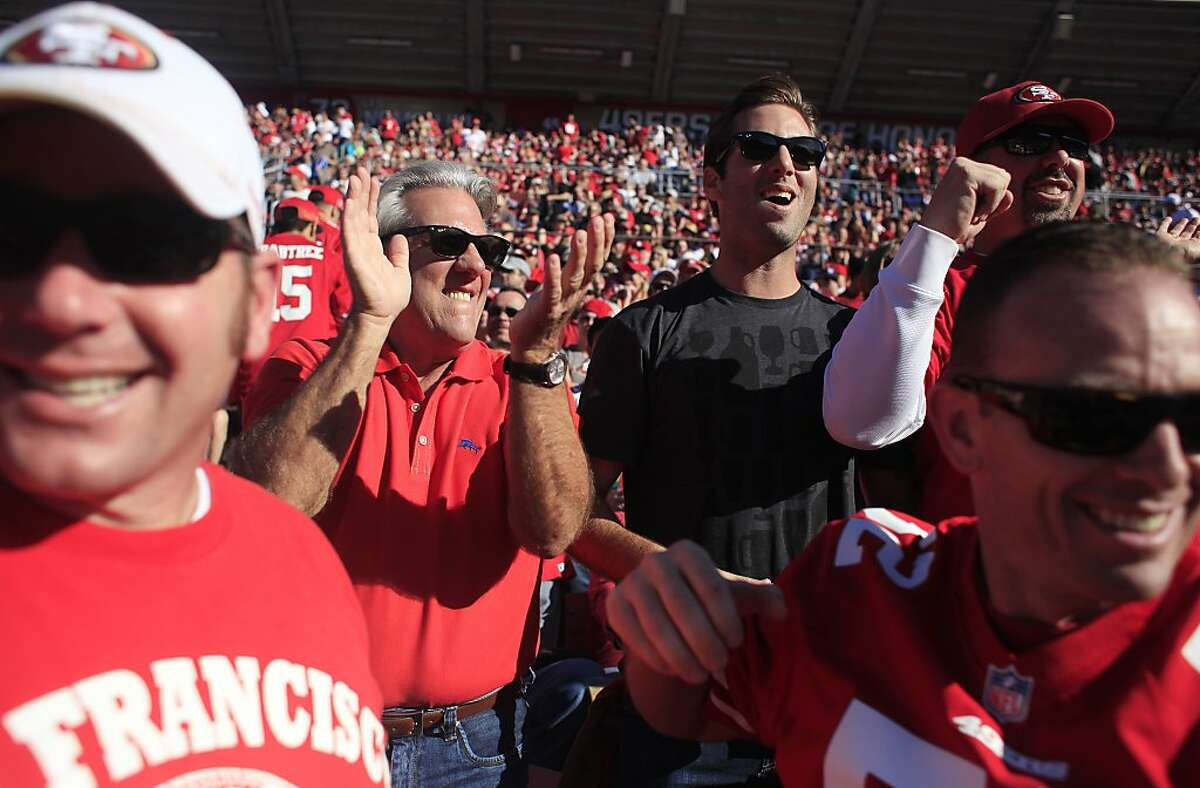 Don Figone, 62, and his son Andy Figone cheer from their seat during big play on Sunday Dec. 1, 2013, in San Francisco, Calif. The Figone family has had season tickets at Candlestick Park since the day they opened in 1971 and had six seats at Kezar Stadium for years before. Don Figone said he will not be renewing his season tickets at the new stadium in Santa Clara.