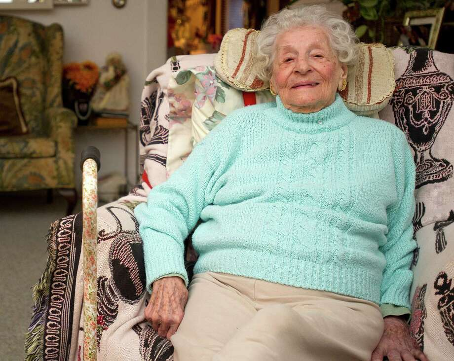 Jane Koproski Olive, 102, sits in her south end home as she discusses her childhood and the changes she has seen in Stamford on Friday, December 20, 2013. Photo: Lindsay Perry / Stamford Advocate