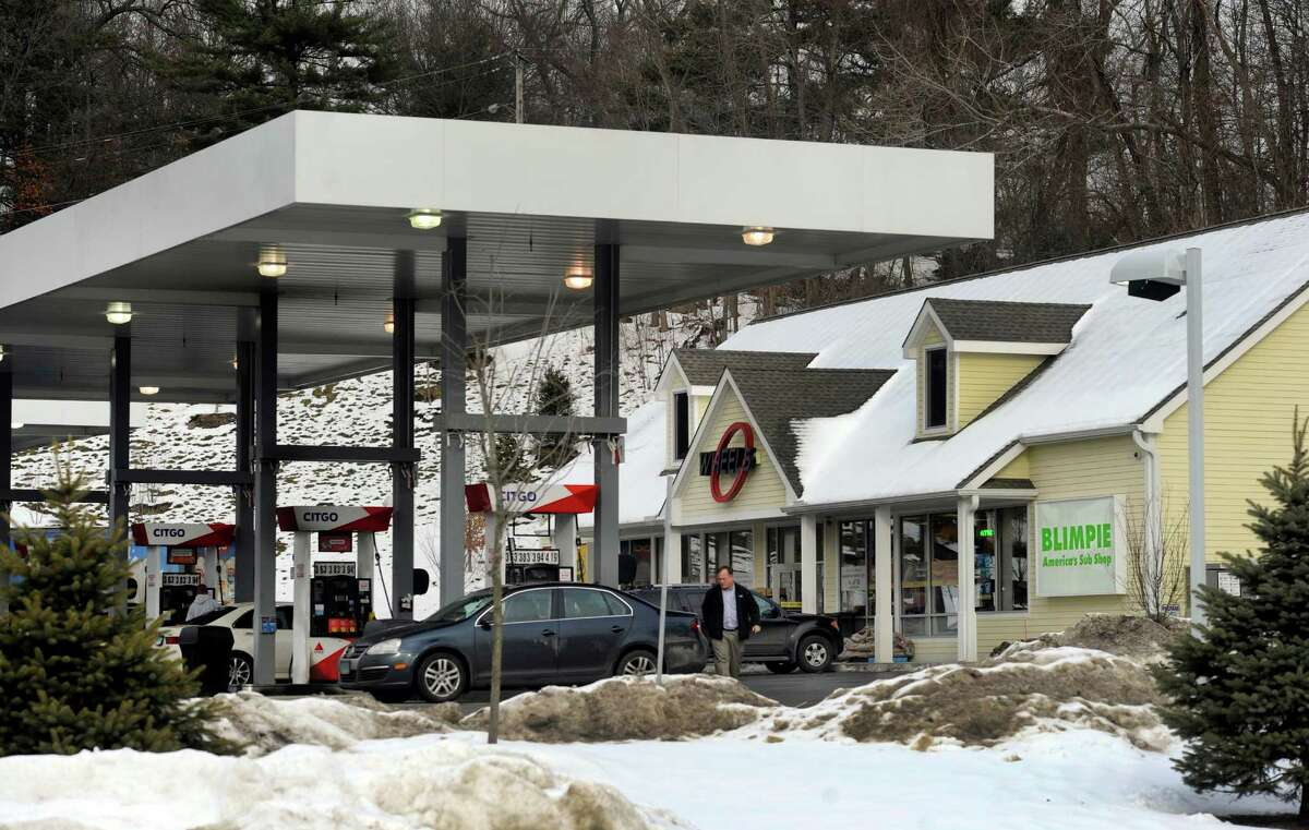 A local man was burned early Friday morning when an explosion at a gas pump caused a fire at the Wheels Gas Station on Tamarack Road in Danbury, Conn., Friday, Dec. 20, 2013.