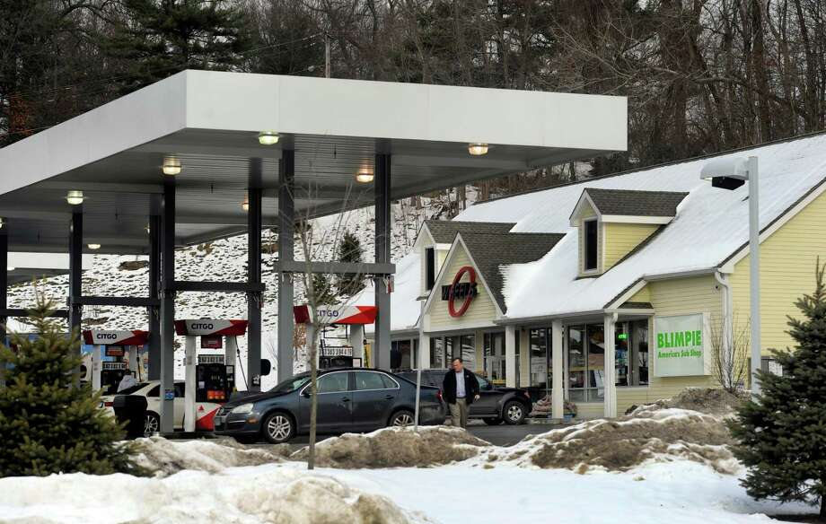 A local man was burned early Friday morning when an explosion at a gas pump caused a fire at the Wheels Gas Station on Tamarack Road in Danbury, Conn., Friday, Dec. 20, 2013. Photo: Carol Kaliff / The News-Times