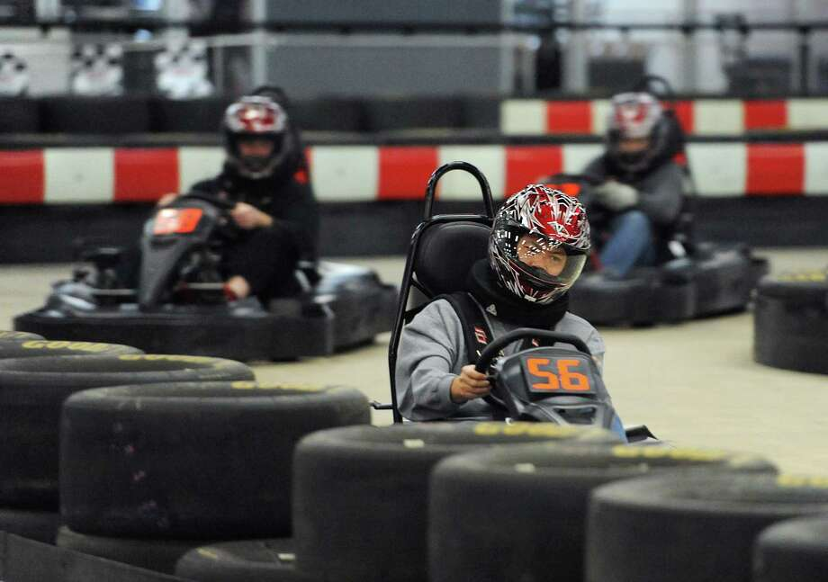 Junlu Luo (56) leads a group of karters during a business group outing for Document Data Solutions at On Track Karting in Brookfield, Conn. on Friday, Dec. 20, 2013.  The indoor go kart racing facility features an 1,800-foot track that is one of the longest and fastest indoor tracks on the East Coast.  On Track Karting has an adult racing league every Thursday night and a junior winter league on Sunday starting January 5, as well as a monthly 60-minute Ironman race.  The facility also hosts parties and large group events. Photo: Tyler Sizemore / The News-Times