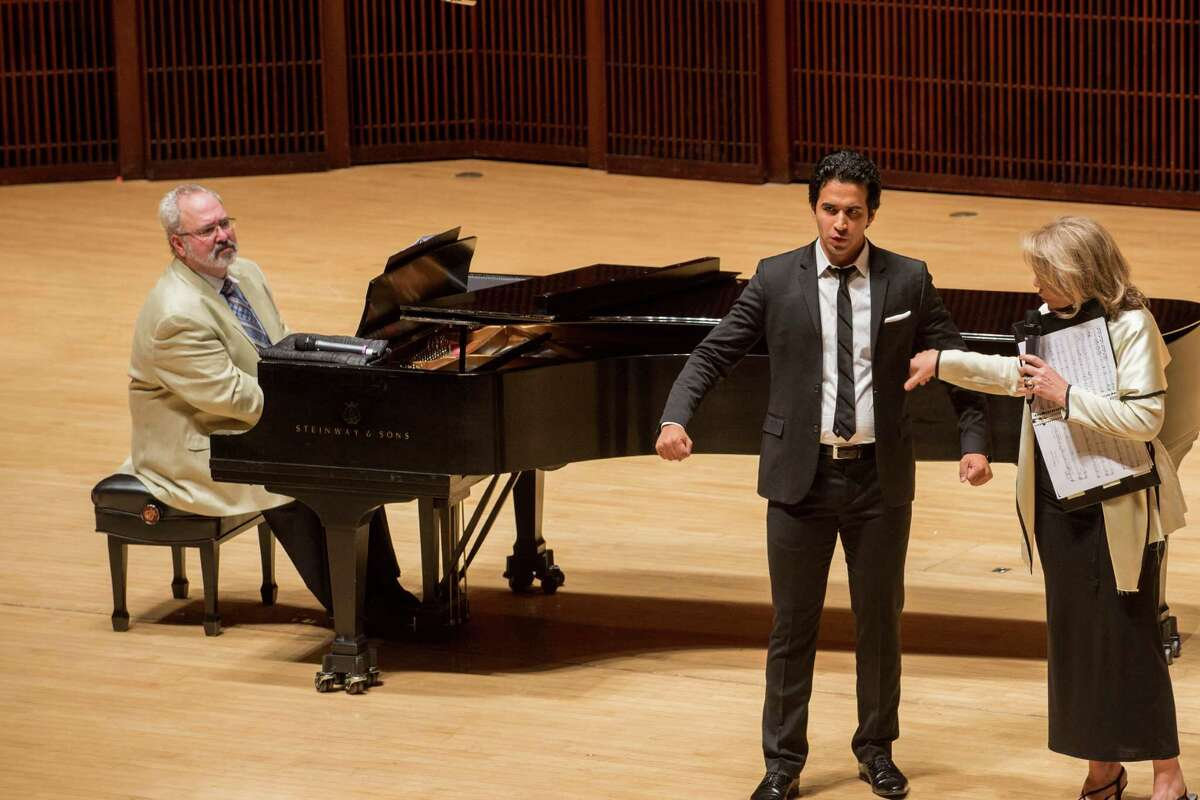 Soprano Renee Fleming works with student Rafael Moras on his breathing during a master class with Rice University voice students.